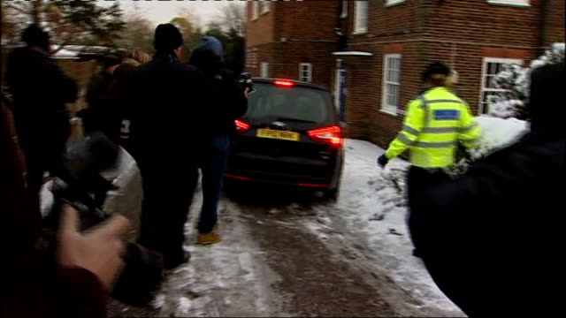 assange along in car to beccles police station as press pack take photographs assange along to station as responds to photographer's request to look... - cricket tor stock-videos und b-roll-filmmaterial