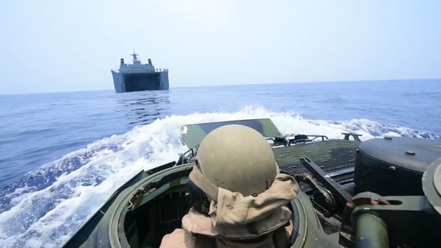 Assault amphibious vehicles assigned to Combat Assault Company 3rd Marine Regiment conduct amphibious operations for the first time with the...