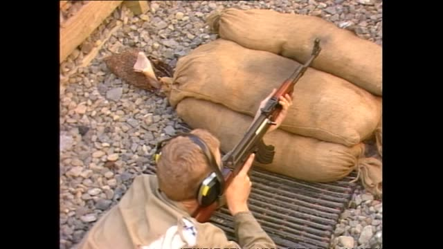 assault rifle being fired and ammunition magazine being loaded with bullets during target practice in new zealand in 1987 - praticare video stock e b–roll
