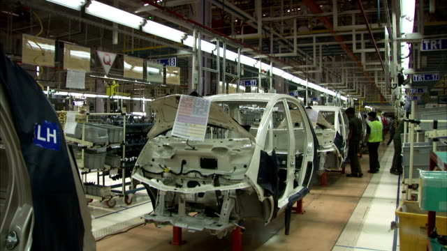 assembly line in progress in car factory available in hd - manufacturing occupation stock videos & royalty-free footage