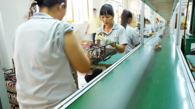 assembly line workers producing products china time lapse - economia video stock e b–roll