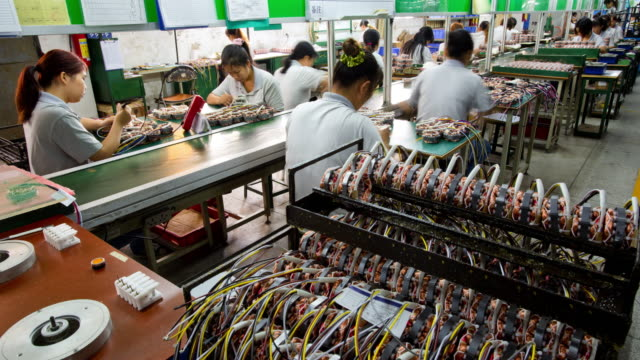 assembly line workers producing products china time lapse - finance and economy stock videos & royalty-free footage