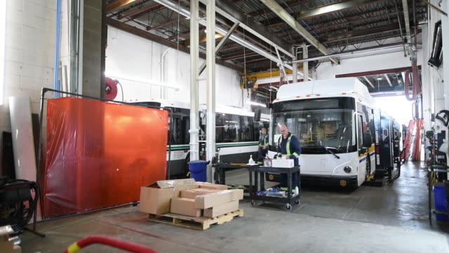 assembly testing repairs and servicing of grande west transportation group buses factory in vancouver british columbia canada on thursday august 2018 - nutzfahrzeug stock-videos und b-roll-filmmaterial