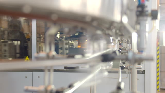 assembly-line production environmentally friendly production warehouse with the products. - bottling plant stock videos and b-roll footage