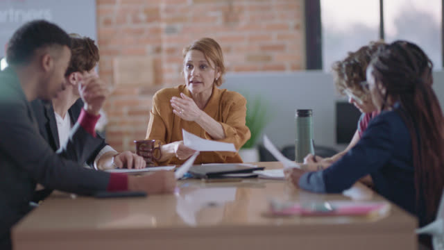 assertive businesswoman takes control and leads an important business meeting - bossy stock videos & royalty-free footage