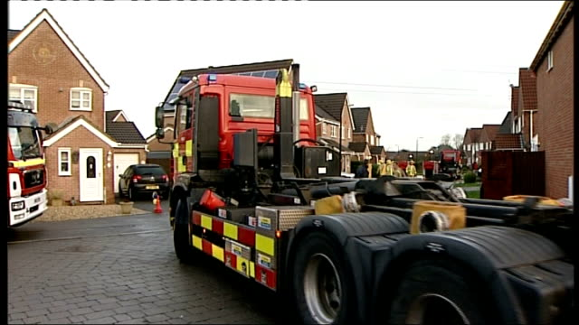 assessment of south west england flood damage; malmesbury: fire engine outside building / skip filled with flood damaged possessions somerset: fire... - in front of点の映像素材/bロール