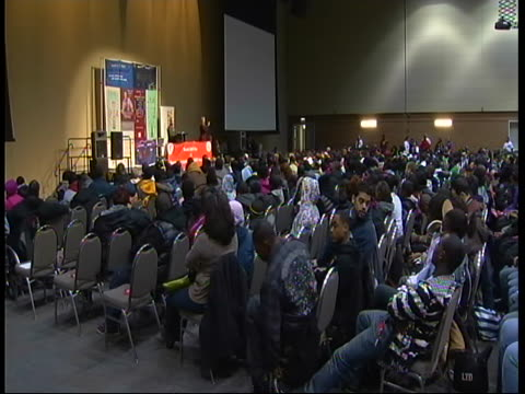 """assistant commissioner of chicago's health department , chris brown speaks to students on world aids day in 2010. """"we hold the latest hiv and aids... - retrovirus video stock e b–roll"""