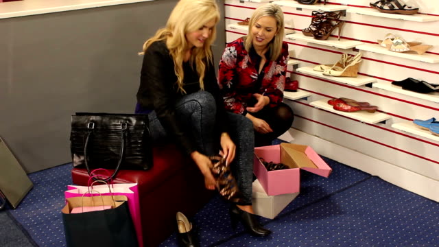 assistant helping customer in shoe shop - wide - dress shoe stock videos and b-roll footage