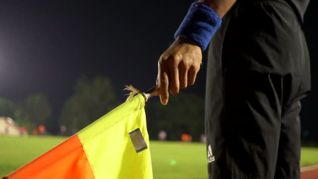 vídeos de stock e filmes b-roll de assistant referees in action during a soccer match - authority