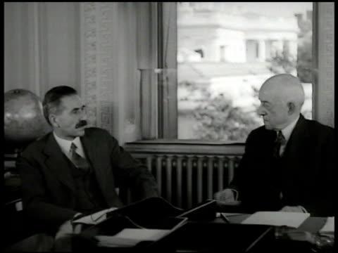vídeos y material grabado en eventos de stock de assistant secretary of state moore sitting in office w/ joseph c. green chief of arms & munitions control. - 1935