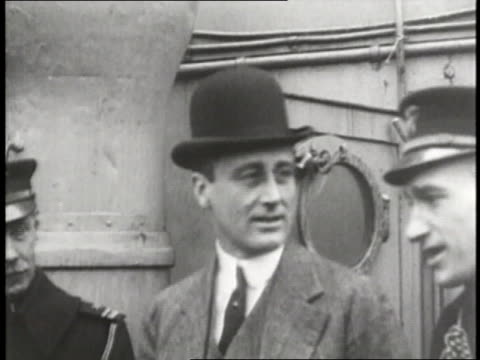 assistant secretary of the navy franklin d roosevelt talks to a crowd after presenting a man with a trophy - 1910 stock-videos und b-roll-filmmaterial