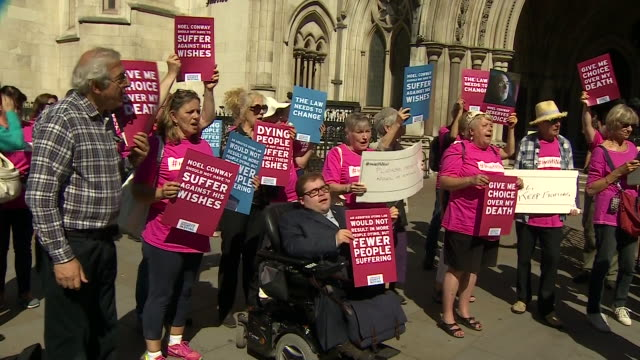 assisted dying supporters and supporters of noel conway protesting outside the royal courts of justice - euthanasia stock videos & royalty-free footage
