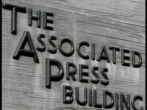 associated press building rockefeller center cu 'ap' sign int ws reporters in news room vs cu old newspaper 'gettysburg wilson reelected world war... - gettysburg stock-videos und b-roll-filmmaterial