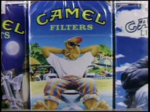 vidéos et rushes de assorted camel cigarettes on sale at convenience store. - cigarette