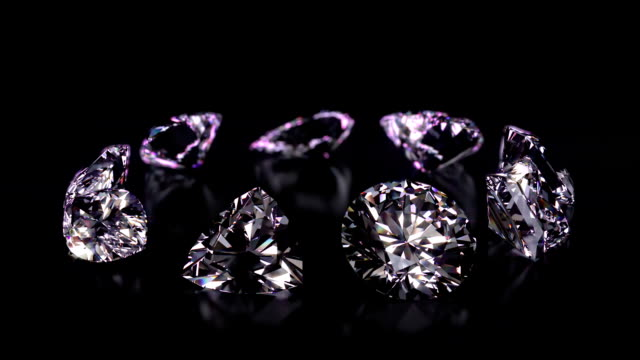 Assorted different shaped diamonds revolving