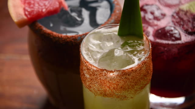 assorted tropical cocktails (strawberry margarita, mexican cantarito paloma, pineapple vodka and tequila cocktail) - tropical cocktail stock videos & royalty-free footage