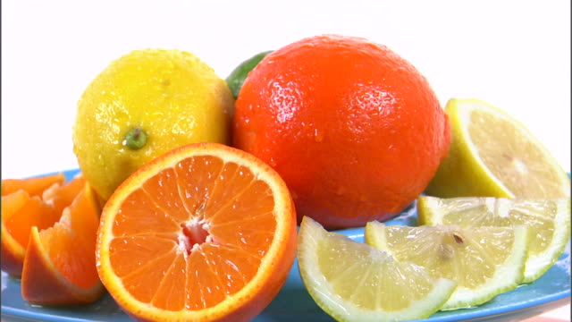 ms assortment of citrus fruits rotating against white background / orem, utah, usa - fruit bowl stock videos & royalty-free footage