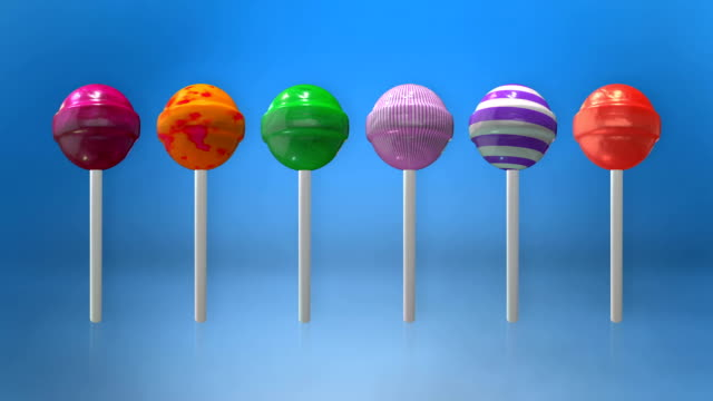 assortment of colorful lollipops animation loop with luma matte - lollipop stock videos and b-roll footage