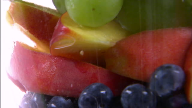 cu tu assortment of fruit in bowl / orem, utah, usa - fruit bowl stock videos & royalty-free footage