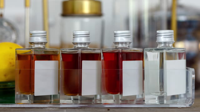 assortment of small liquor bottles in hotel room - scotch whiskey stock videos & royalty-free footage