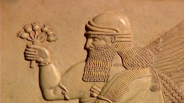 assyrian winged guardian. mcu of archaeological relief carved in stone showing head and upper body. - ancient stock videos & royalty-free footage