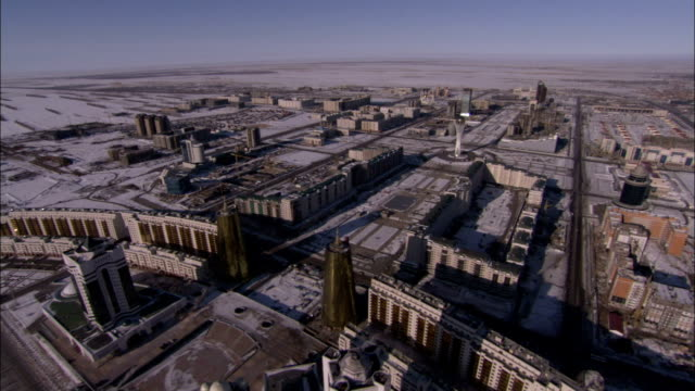 astana kazakhstan is seen from the air on a wintry day. available in hd. - kazakhstan stock videos and b-roll footage