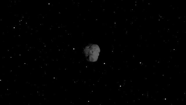 Asteroide através de espaço
