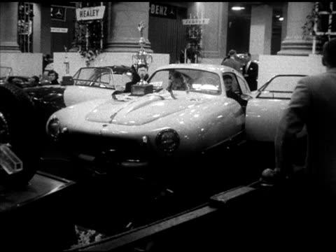 aston martin db2 vantage , spanish pegaso z102 coupe w/ trophy on hood , mercedes benz 300s convertible, italian ferrari 212 inter pinin farina coupe... - mercedes benz markenname stock-videos und b-roll-filmmaterial