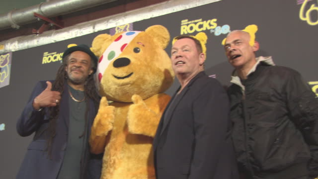 vidéos et rushes de astro, ali campbell, and michael virtue, ub40 at bbc children in need rocks the 80s at sse arena on october 19, 2017 in london, england. - bbc children in need