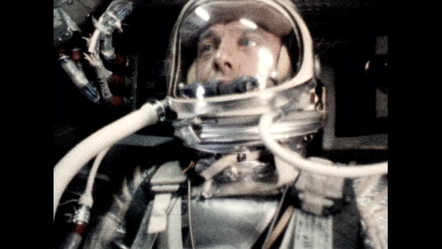 vídeos de stock e filmes b-roll de astronaut alan shepard in freedom 7 capsule as he becomes the first american in space on may 05 1961 in in space - 1961
