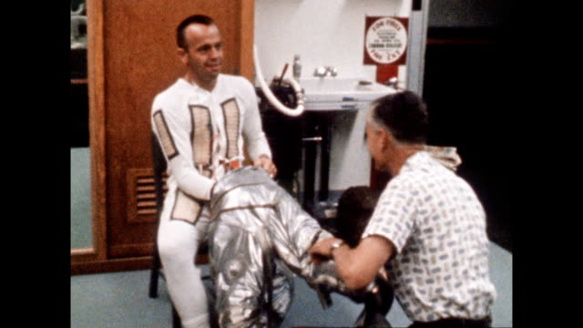 vídeos de stock e filmes b-roll de astronaut alan shepard suiting up for project mercury iii mission on july 28 1961 in cape canaveral florida - 1961