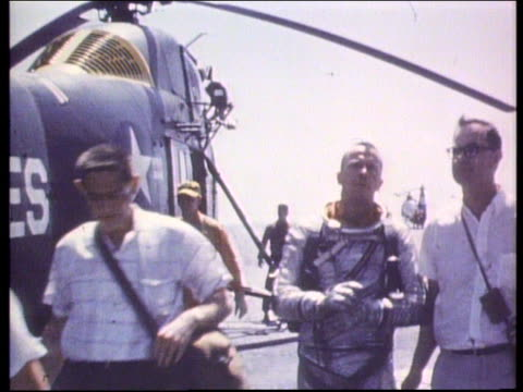 astronaut alan shepard walking away from helicopter after splashdown - 1961 stock videos & royalty-free footage