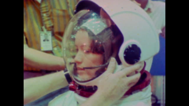 astronaut anna lee fisher is helped into a spacesuit before she climbs down into a pool of water, where she floats submerged as nasa scientists take... - 1981 stock videos & royalty-free footage