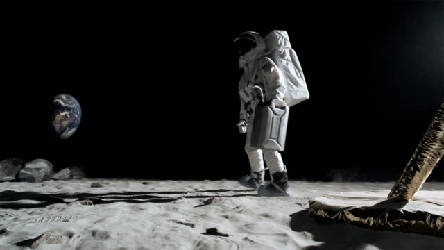ws pan slo mo astronaut carrying gas can, kicking sand and running / berlin, germany - treten stock-videos und b-roll-filmmaterial