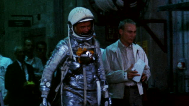 ms astronaut climbing aboard mercury space capsule, with john glenn - astronaut stock videos & royalty-free footage