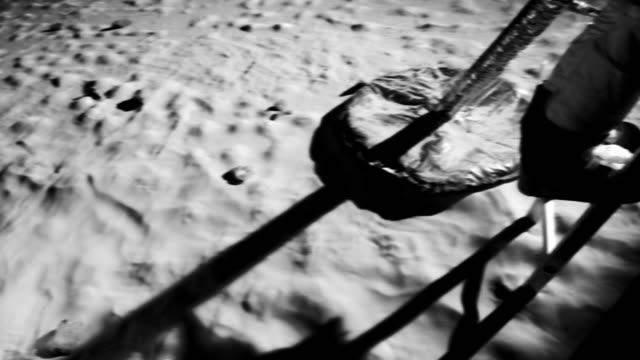ms b/w slo mo astronaut climbing down the ladder of lunar lander on moon / berlin, germany - moving down stock-videos und b-roll-filmmaterial