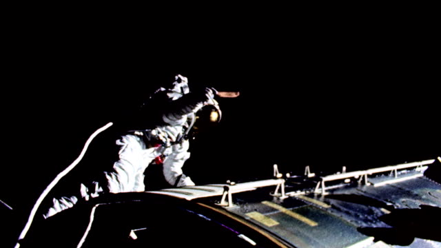 / astronaut conducting extravehicular activity. apollo 17 astronaut on space walk on december 11, 1972 in in space - spacewalk stock videos & royalty-free footage