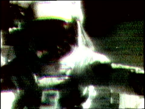 US Astronaut David Scott performs a gravity experiment on the Moon