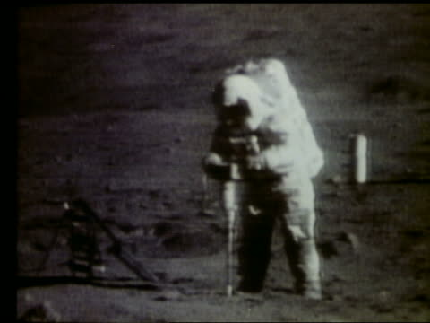 Astronaut drilling hole into Moon surface / Apollo 16
