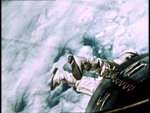astronaut edward white floating in space above earth during gemini iv mission spacewalk - spacewalk stock videos & royalty-free footage