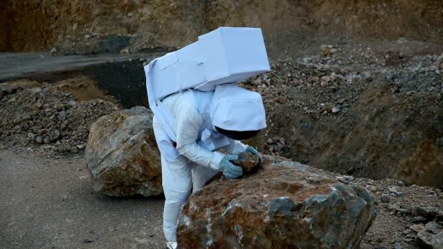 Astronaut exploring rocky Mars