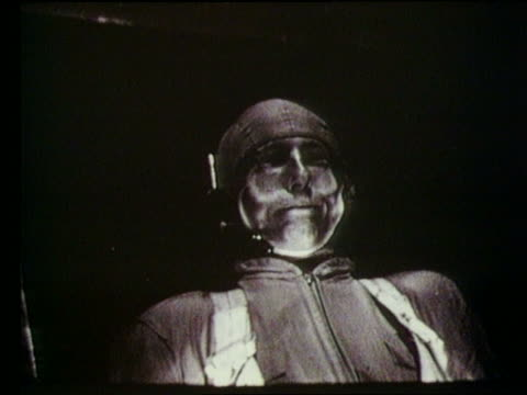 b/w astronaut in g-force test (flappy face) - g force stock videos & royalty-free footage