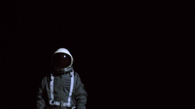 astronaut in space suit walking towards camera - laguna beach california stock videos & royalty-free footage