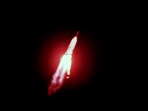 astronaut in spacesuit sitting in friendship 7 space capsule during the mercury 6 mission / mercury 6 rocket ascending in sky as john glenn is first... - 1962 stock videos & royalty-free footage
