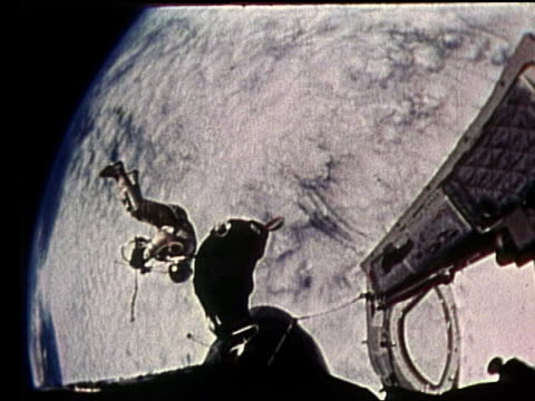 astronaut in spacesuit tethered to ship in space - gemini 4 stock videos and b-roll footage