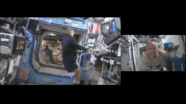 astronaut jeff williams mounts two hd camcorders together and gives an interesting perspective flying through the international space station during... - international space station stock videos & royalty-free footage