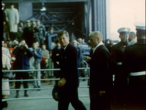astronaut john glenn and u.s. president john f. kennedy walk past troops as they arrive in cape canaveral, florida. - planet earth stock videos & royalty-free footage
