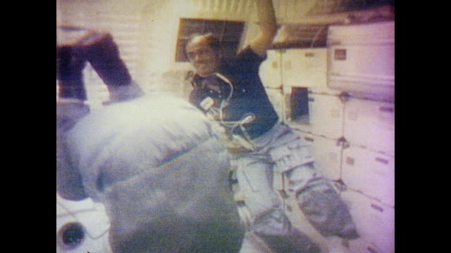 astronaut john young performs a forward roll as he floats next to roger crippen during their televised transmission - anno 1981 video stock e b–roll