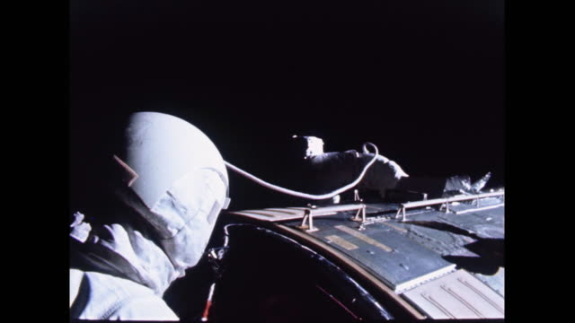 astronaut ken mattingly retrieving the camera on the outside of the comand module - spacewalk stock videos & royalty-free footage