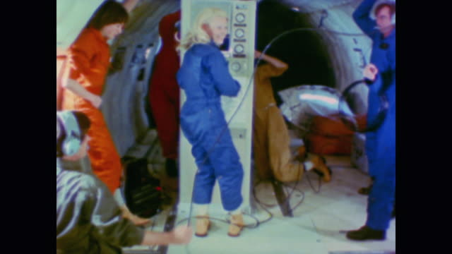 Astronaut Margaret Rhea Seddon and others conduct weightlessness experiments in an airplane